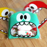 New 100Pcs Cute Big Teech Mouth Monster Plastic Self Sealing Bag Wedding Birthday Cookie Candy Gift Packing Bags